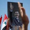 portrait du president syrien lors d'une manifestation de ses partisans à Damas